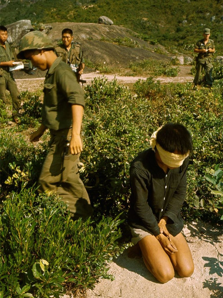 A group of South Korean soldiers with a blindfolded Vietcong suspect